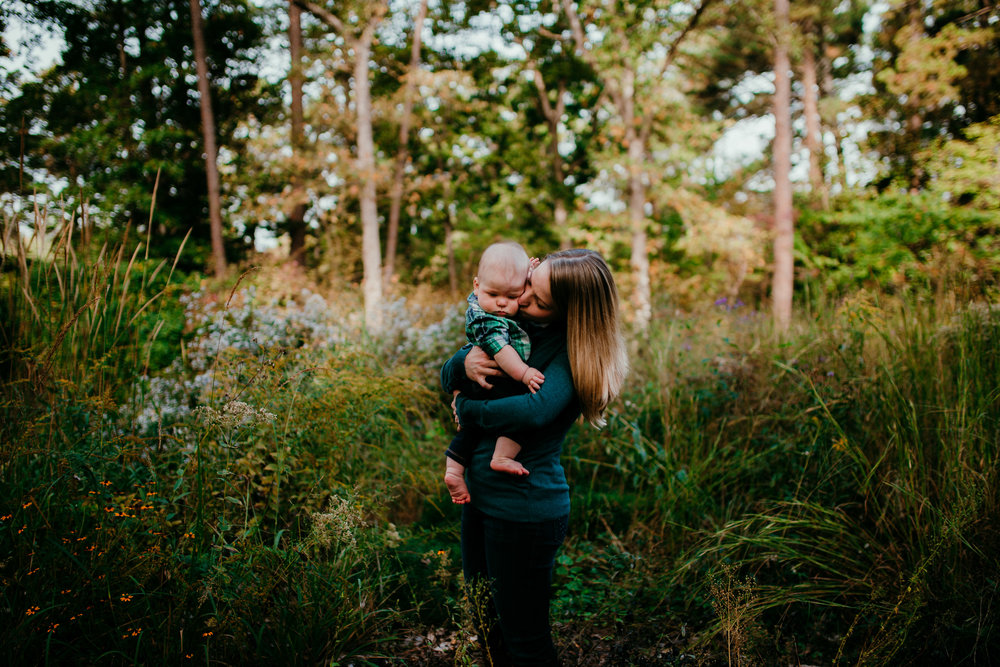 mom and baby having a sweet moment among the grass during a Fall Family session at Duke Gardens in Durham North Carolina | Hanna Hill Photography | Raleigh birth and family photographer