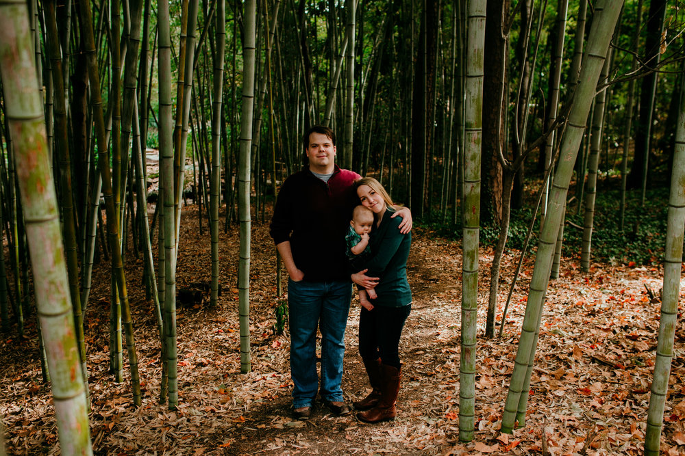 The family poses among the bamboo during their fall family session at Duke gardens in Durham, North Carolina | Hanna Hill photography | Raleigh birth and family photographer