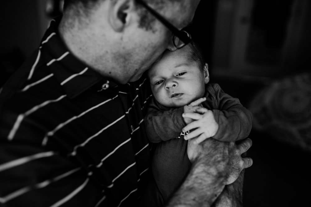 a sweet moment with dad and baby during an in home newborn session | Hanna Hill Photography | Raleigh birth and a family photographer | Raleigh newborn photographer