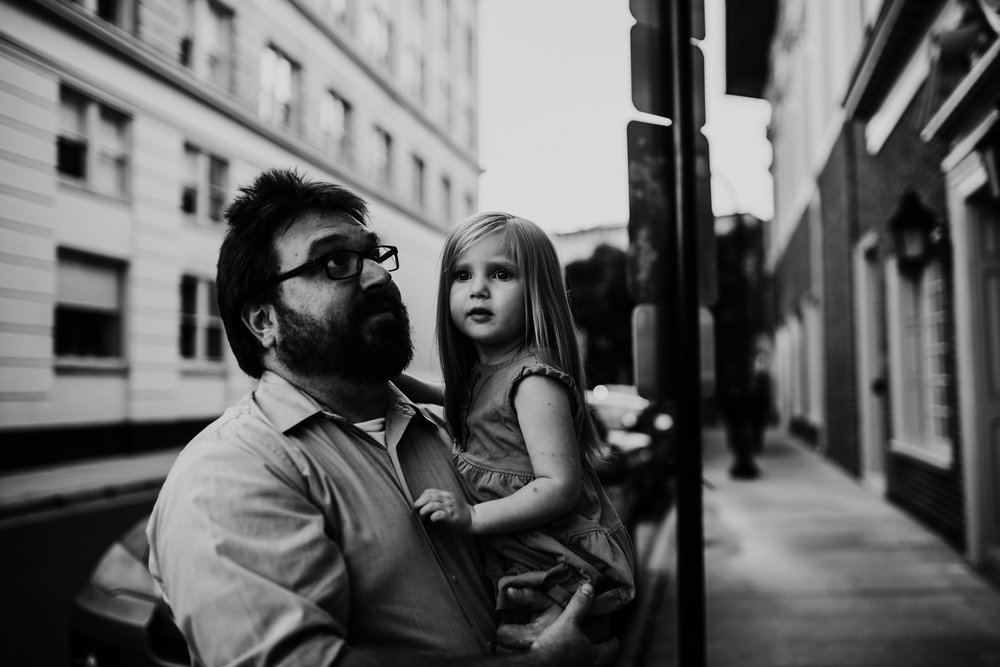 daddy and daughter exploring downtown durham, NC in their family photography session | Hanna Hill Photography | Raleigh birth and family photographer