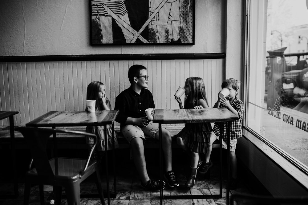 the kiddos sitting in the ice cream parlor waiting for their ice cream cones during their downtown family photography session | Hanna Hill Photography | Raleigh birth and family photographer