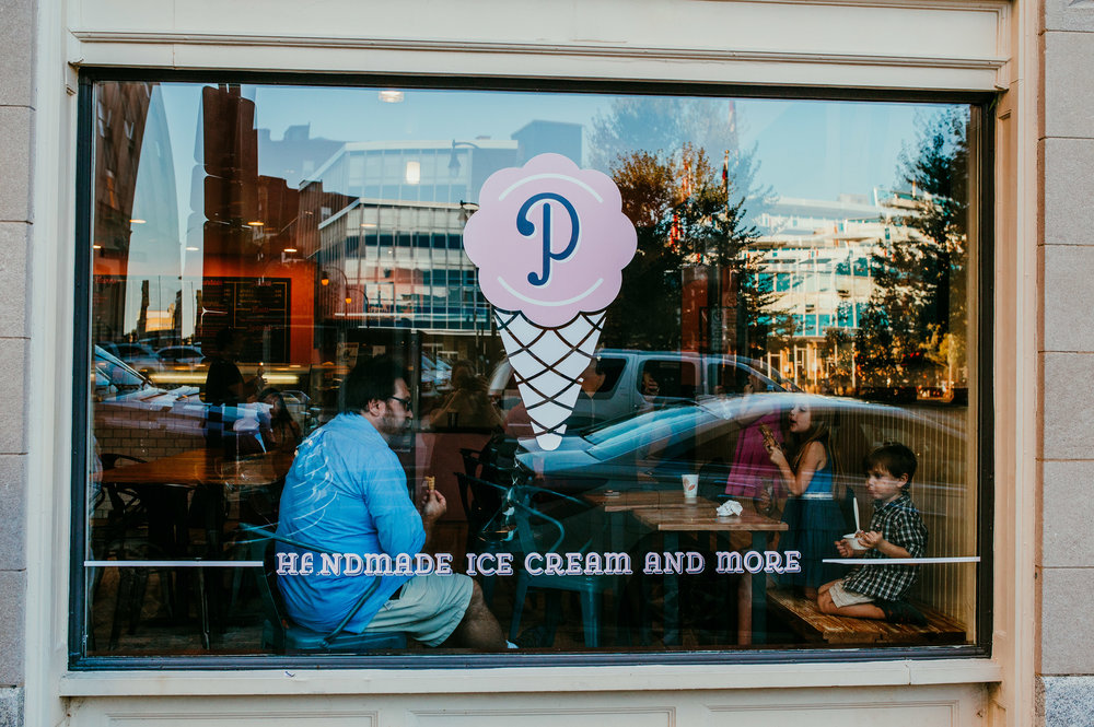 family getting ice cream shot through the window at the parlour ice cream shop in downtown durham, NC | Hanna Hill Photography | Raleigh birth and family photographer