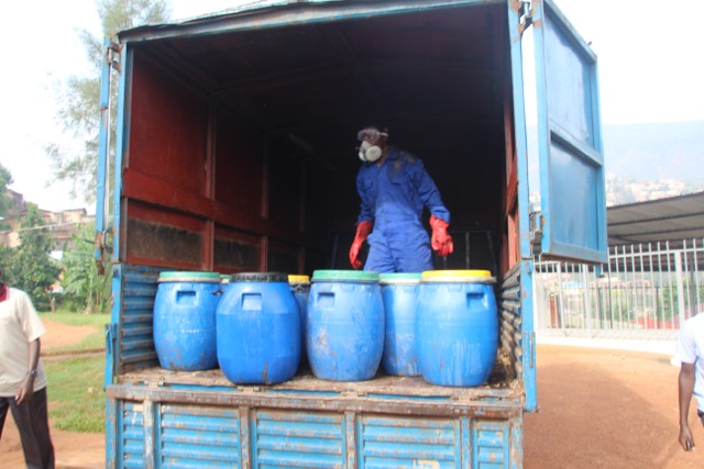 Loading full barrels into the truck for transport to Pivot Works factory.
