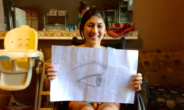 Gaby with the product of her first drawing class