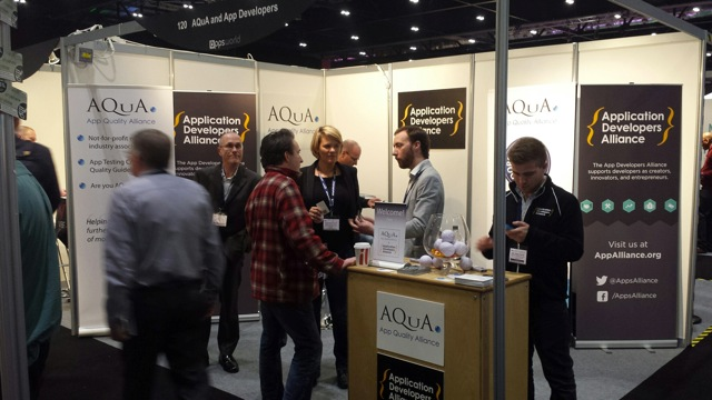The Apps Alliance team chats with visitors to the booth shared with AQuA.