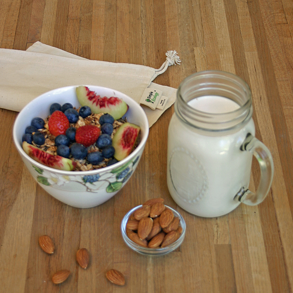 Homemade almond milk, homemade granola, fresh berries & nectarine slices