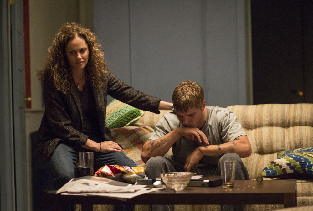 Amy Brenneman as Laurie Garvey, Chris Zylka as Tom Garvey