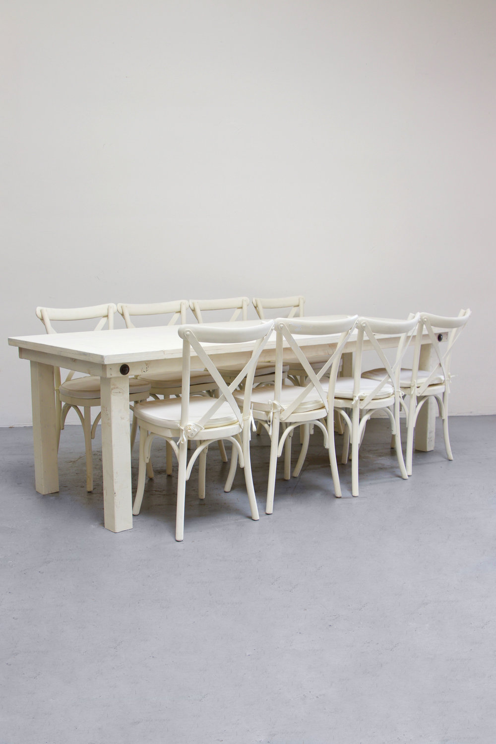 1 Vintage White Farm Table w/ 8 Cross-Back Chairs $145