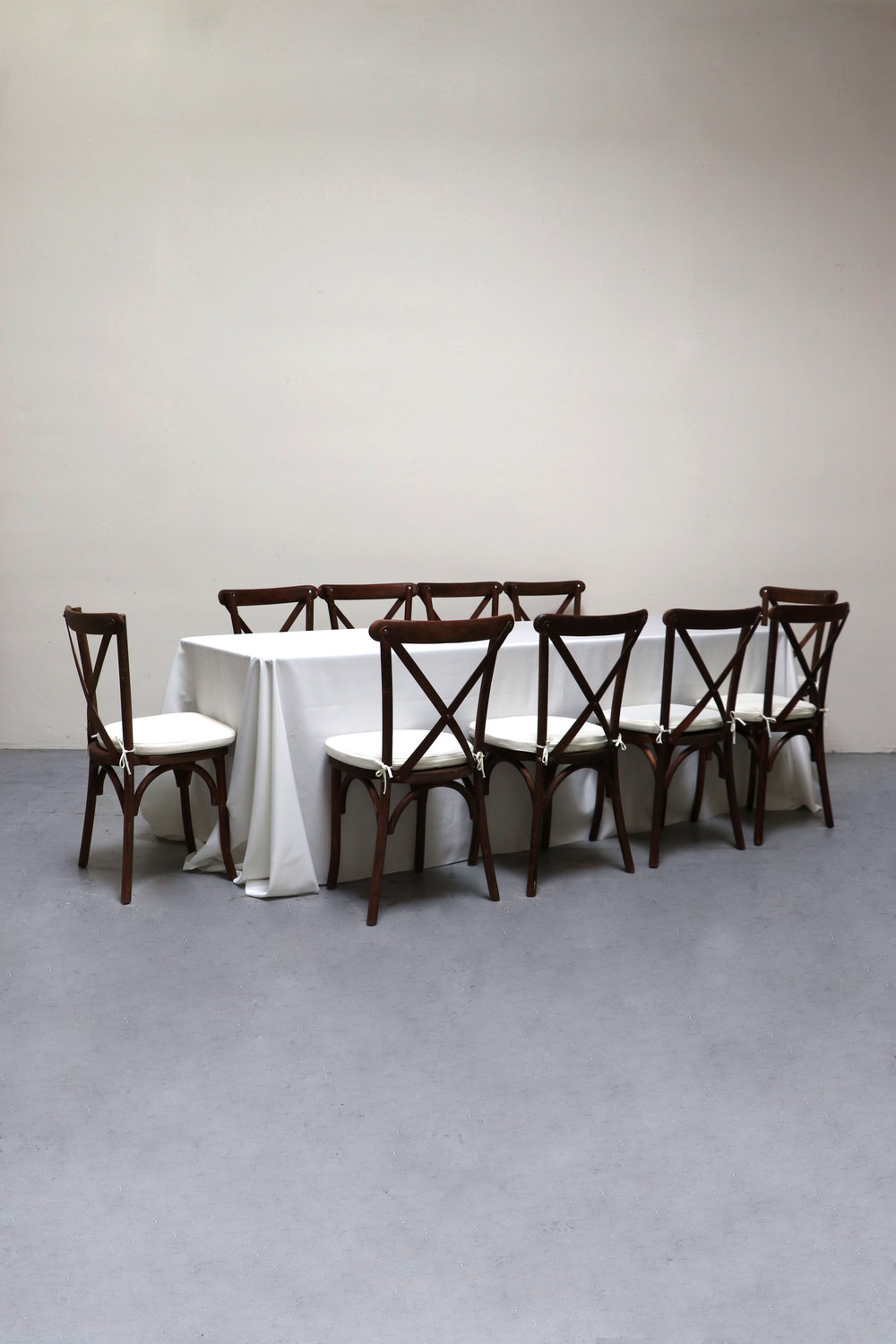 1 Banquet Table with 10 Cross-Back Chairs $100