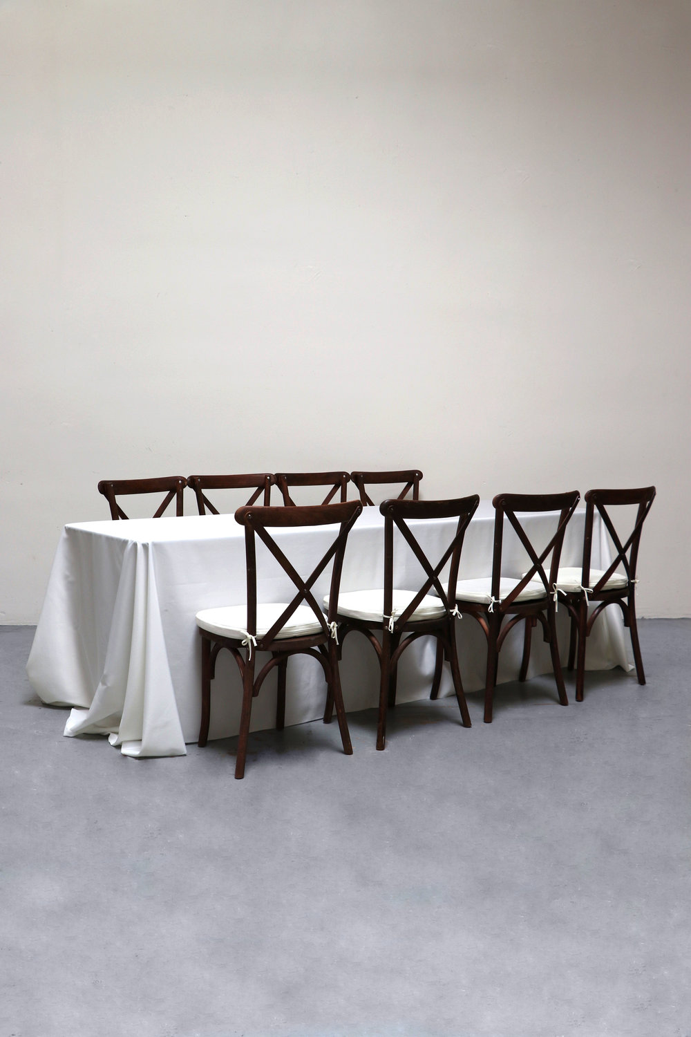 1 Banquet Table with 8 Cross-Back Chairs $80