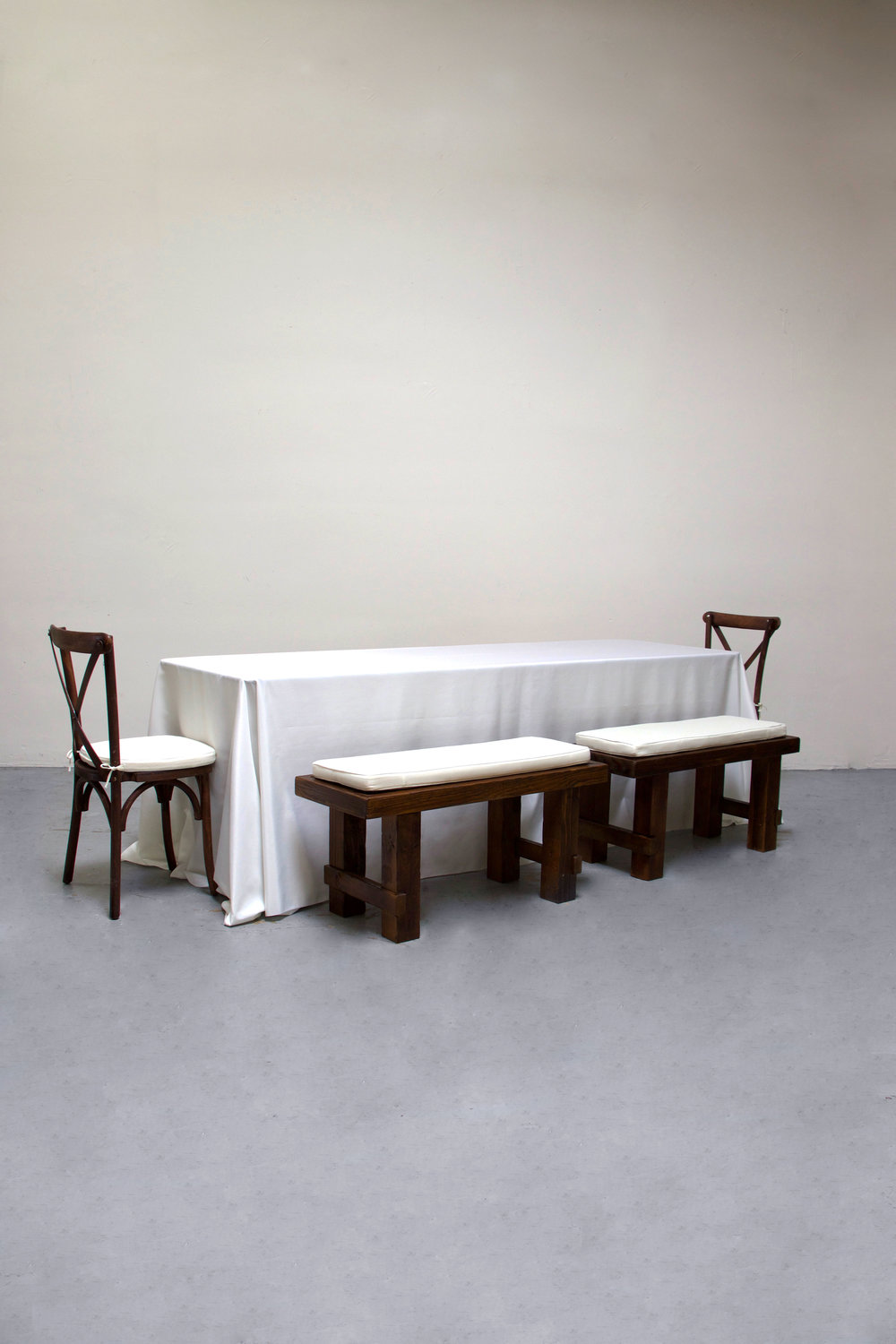 1 Banquet Table with 4 Short Benches & 2 Cross-Back Chairs $100