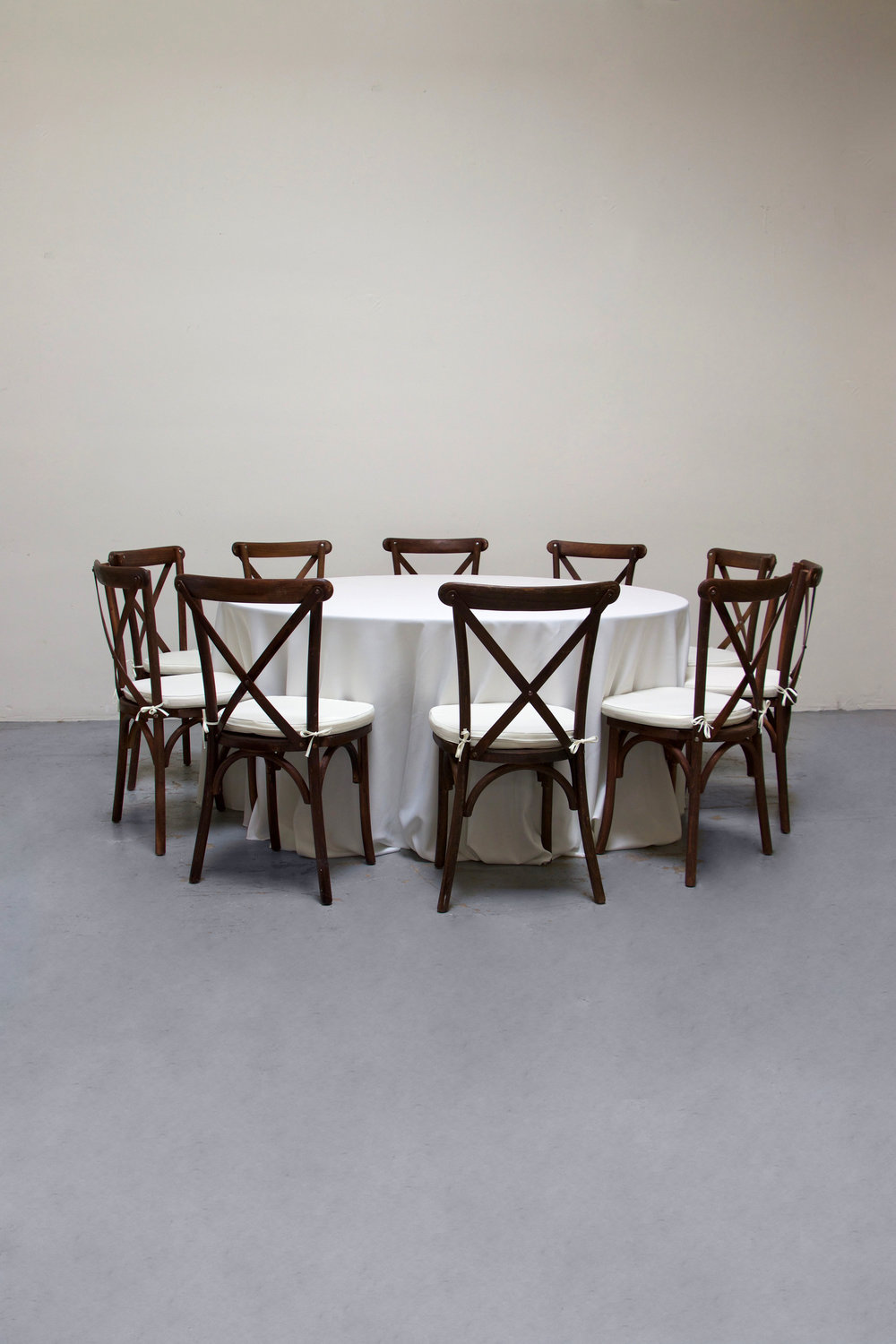 1 Round Banquet w/ 10 Cross-Back Chairs $100