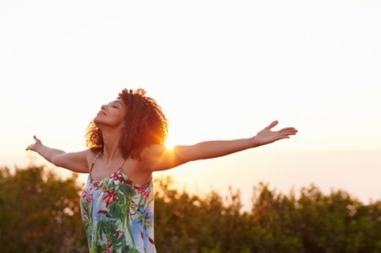 woman arms outstretched in nature.jpg