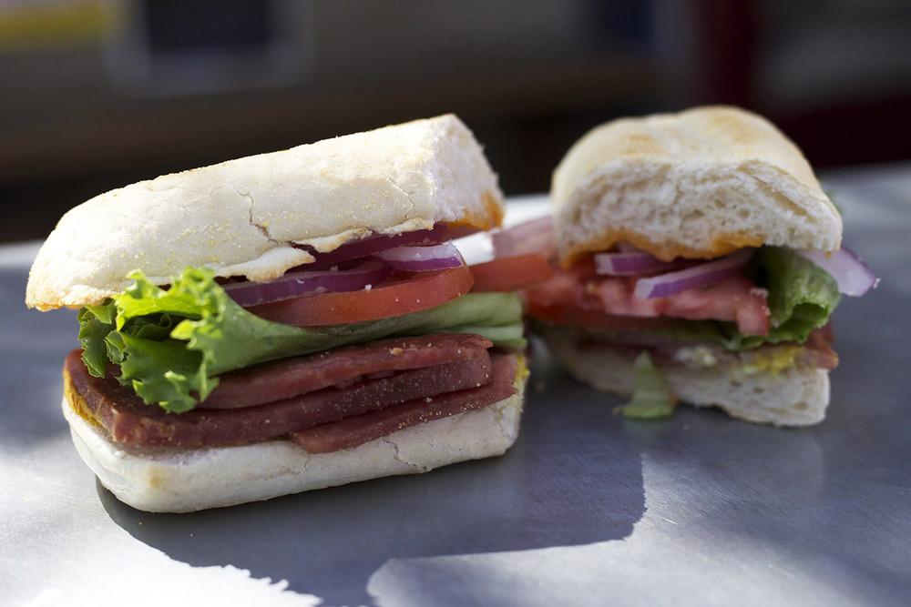 crispy spam • cheddar • mustard • lettuce • tomato • onion