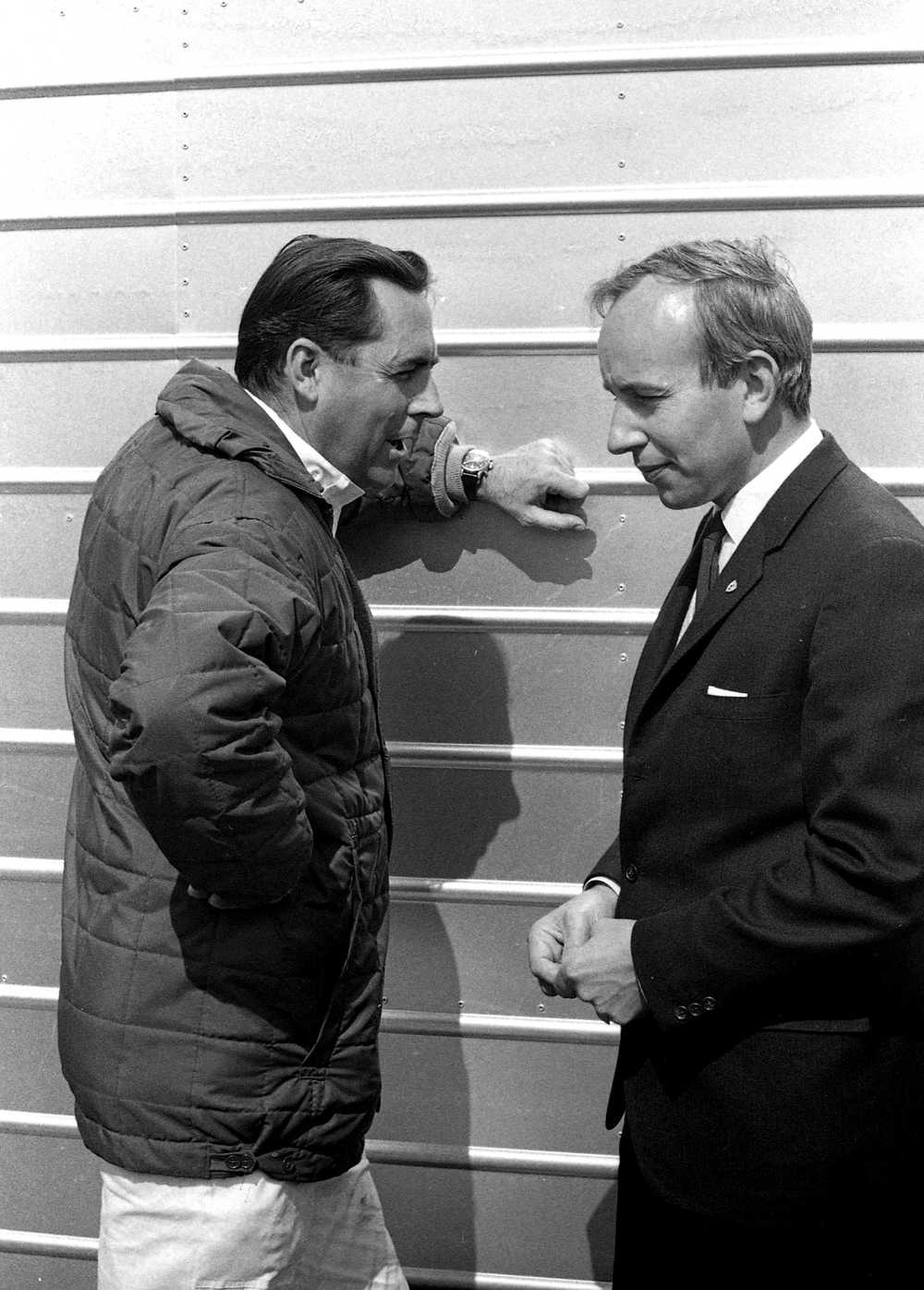 He did speak sometimes. Jack Brabham (left) in deep conversation with John Surtees.