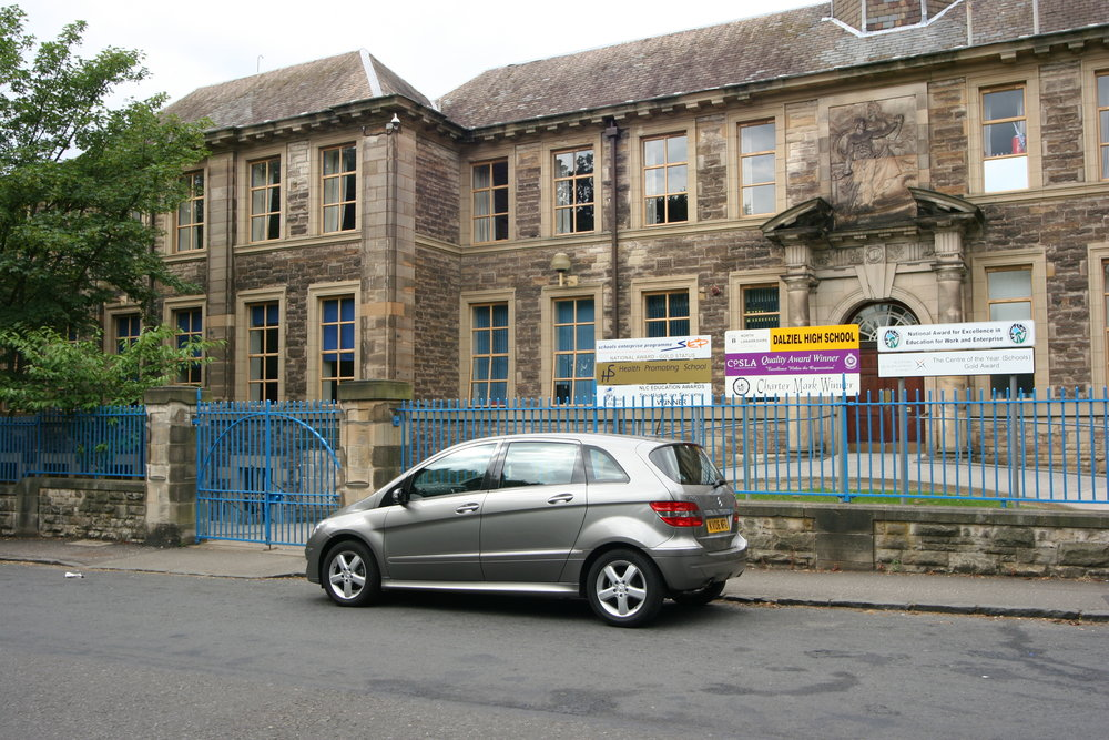 Dalziel High School main entrance with press test Mercedes-Benz