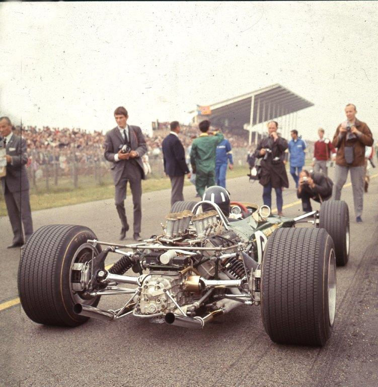 Graham Hill on the main straight at Zandvoort. He went on to win the 1968 World Championship in a 49B. This is the pre-wing era of Formula 1. Chapman put aerofoils on sticks on the 1969 car, and I watched Hill and Jochen Rindt crashing disastrously at the Spanish Grand Prix. Photo © Eric Dymock