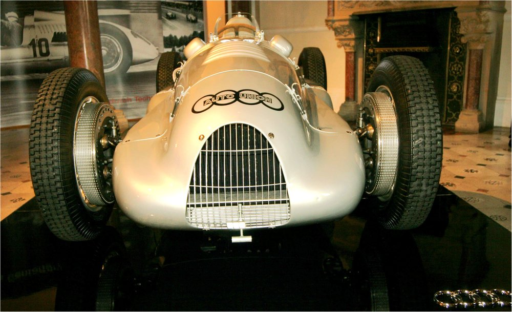 The Type C Auto Union of 1938-1939 had a lighter V12 engine analogous to Formula 1 cars Brabham pioneered, which have persisted ever since