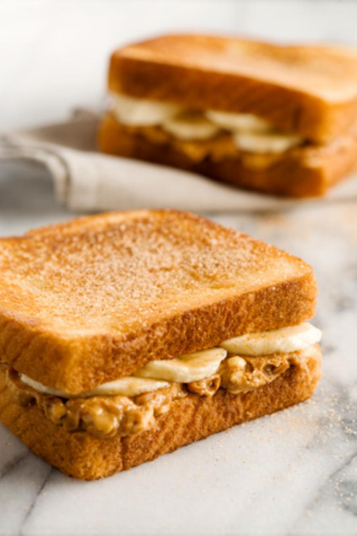 credits:https://www.pauladeen.com/recipe/paulas-fried-peanut-butter-and-banana-sandwich/