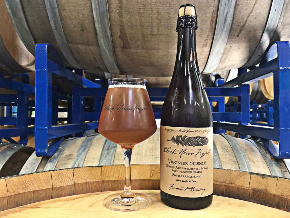 Viognier Silence - Golden Ale refermented in Oak with Viognier GrapesMalt: Skagit Copeland Pilsner, Skagit Wheat, Special Aromatic, DextroseHops: SaazYeast: Giga GoldenFruit: 125 pounds of viognier grapes per barrelABV: 9.4%     IBU: 20