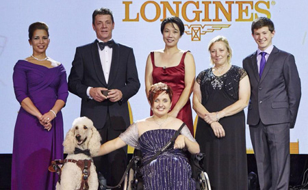 2014 winners from left to right: HRH Princess Haya, Jeroen Dubbeldam, Melissa Tan chairman of equine therapy centre Equal Ark, Jackie Potts, Lambert Leclezio with (centre) Sydney Collier and her service dog Journey. Photo: FEI/Liz Gregg
