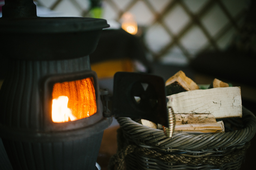 Wood burning stove in yurt, commercial photography