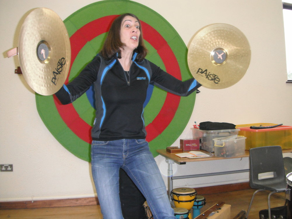 Mary demonstrating the cymbals