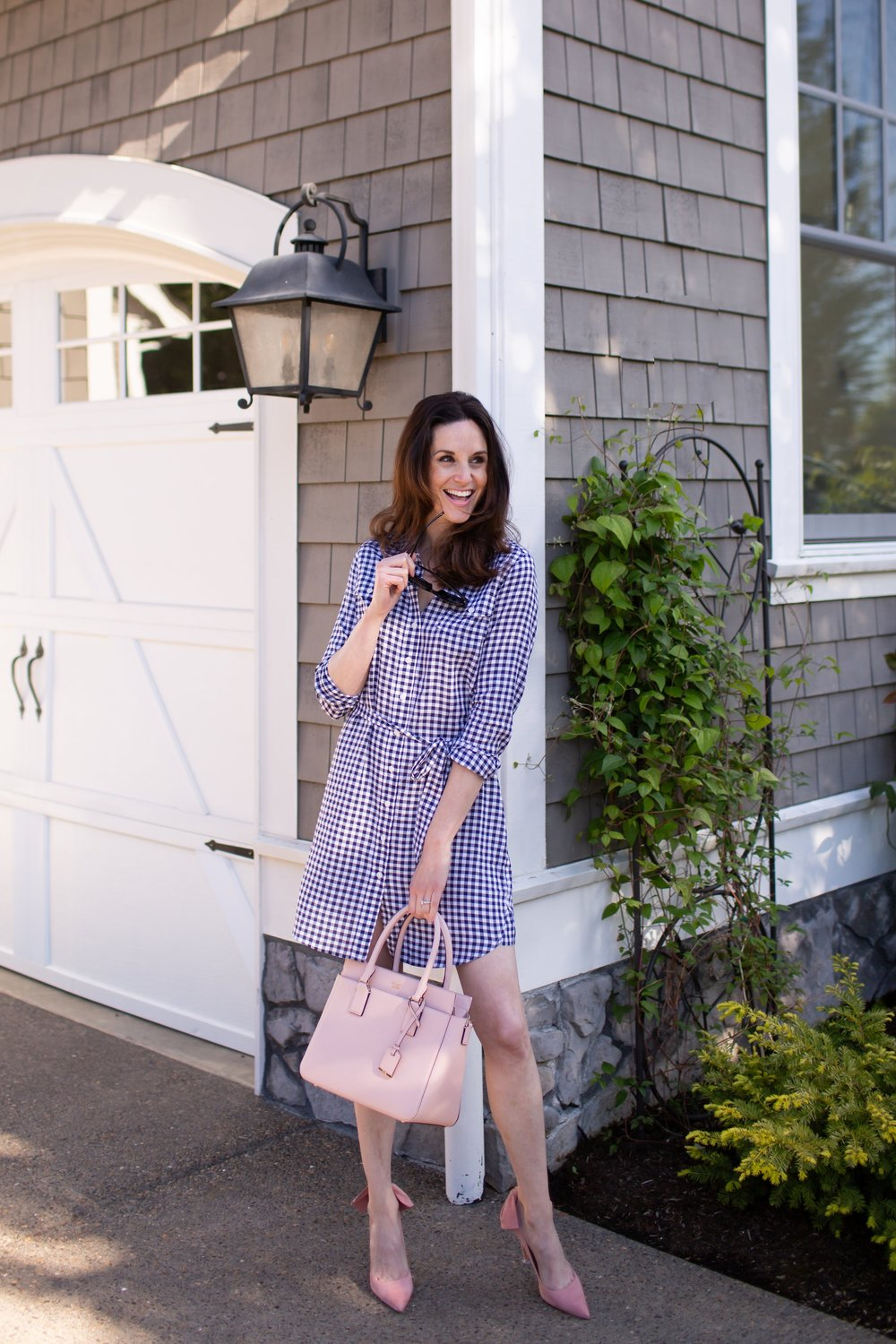 Gianna character wearing a Draper James shirtdress, Kate Spade purse and Schutz shoes.jpg