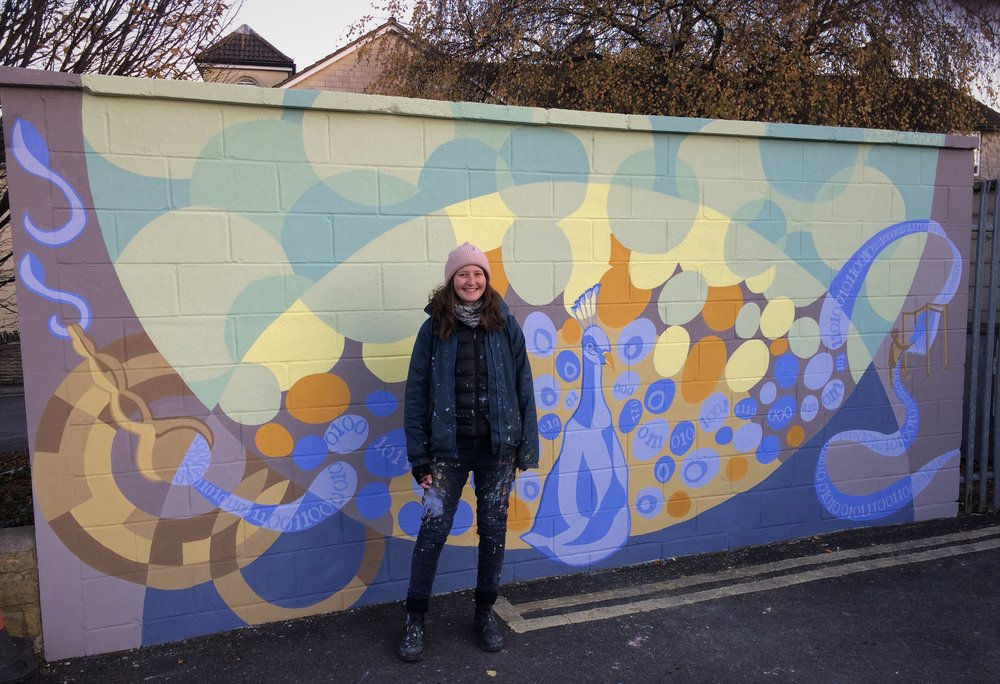 Phoebe next to the finished Mural