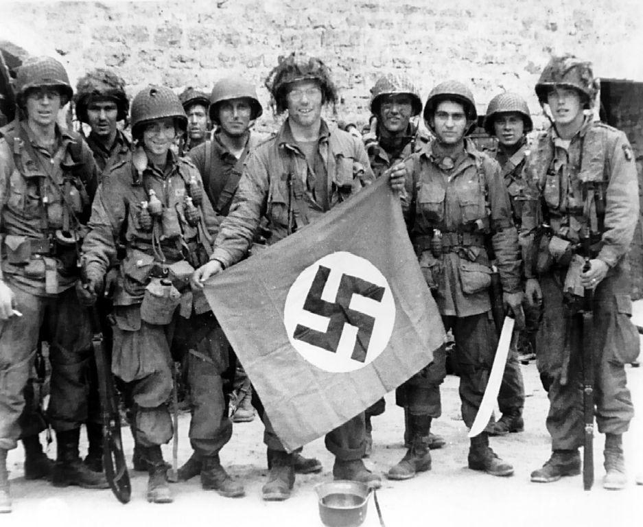Nazi with the flag.jpg
