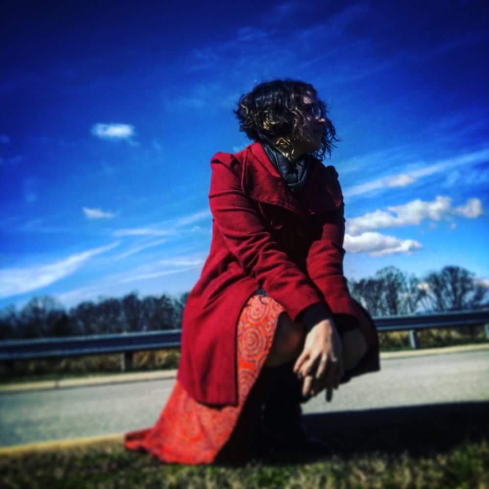 A new hair cut, a twirly skirt, a red coat, and the sunshine.