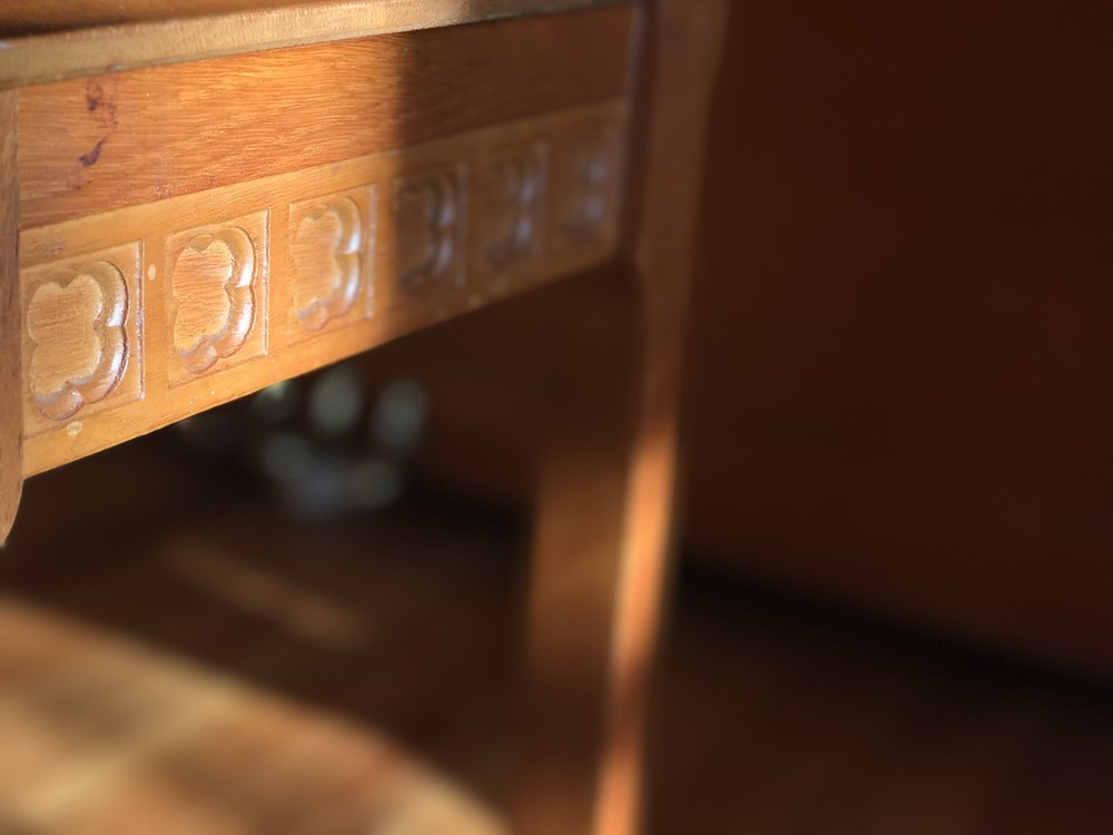 Our piano bench at home in the morning light.