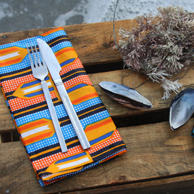 NAPKIN - $4 Our African-wax print Napkin offers vibrant style to your dining experience. Whether at a picnic or in the presence of your own home, these colorful designs will add cheer to your meal. Easy to wash. Great to throw in your bag as a hand-towel when on the go. SUGGESTED RETAIL $8