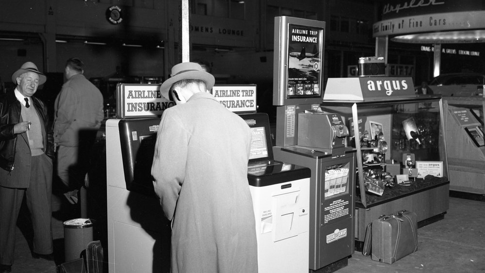 """Travel Insurance Kiosks at Detroit's Willow Run Airport, 1954. Part of the """"Old News"""" collection at the Ann Arbor District Library. ( https://aadl.org/N186_0087_007 )"""