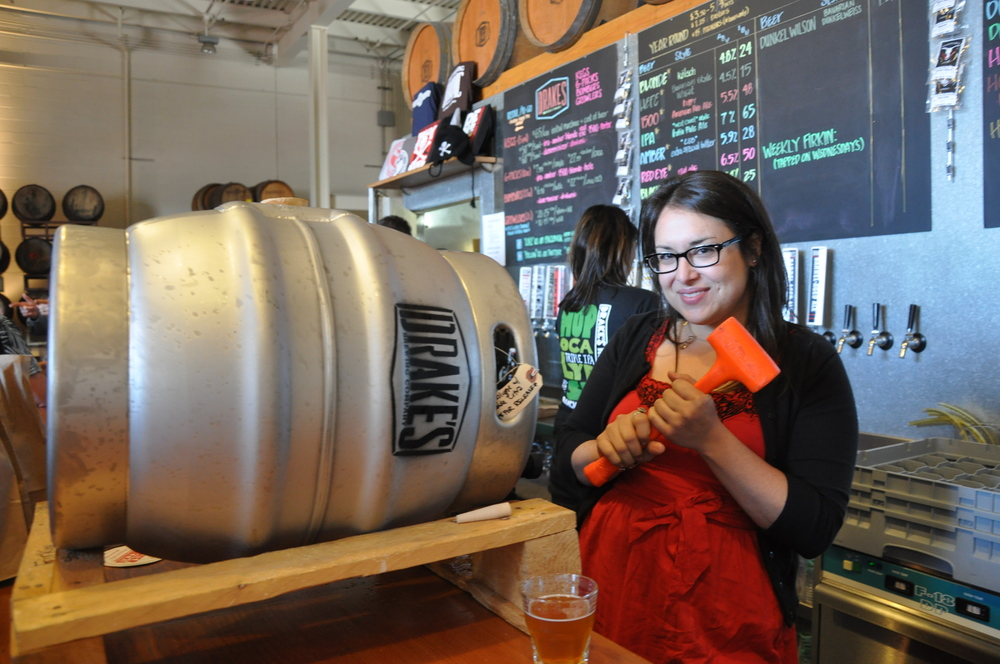 Tapping a firkin in the Drake's Barrel House. Photo: Mike Condie