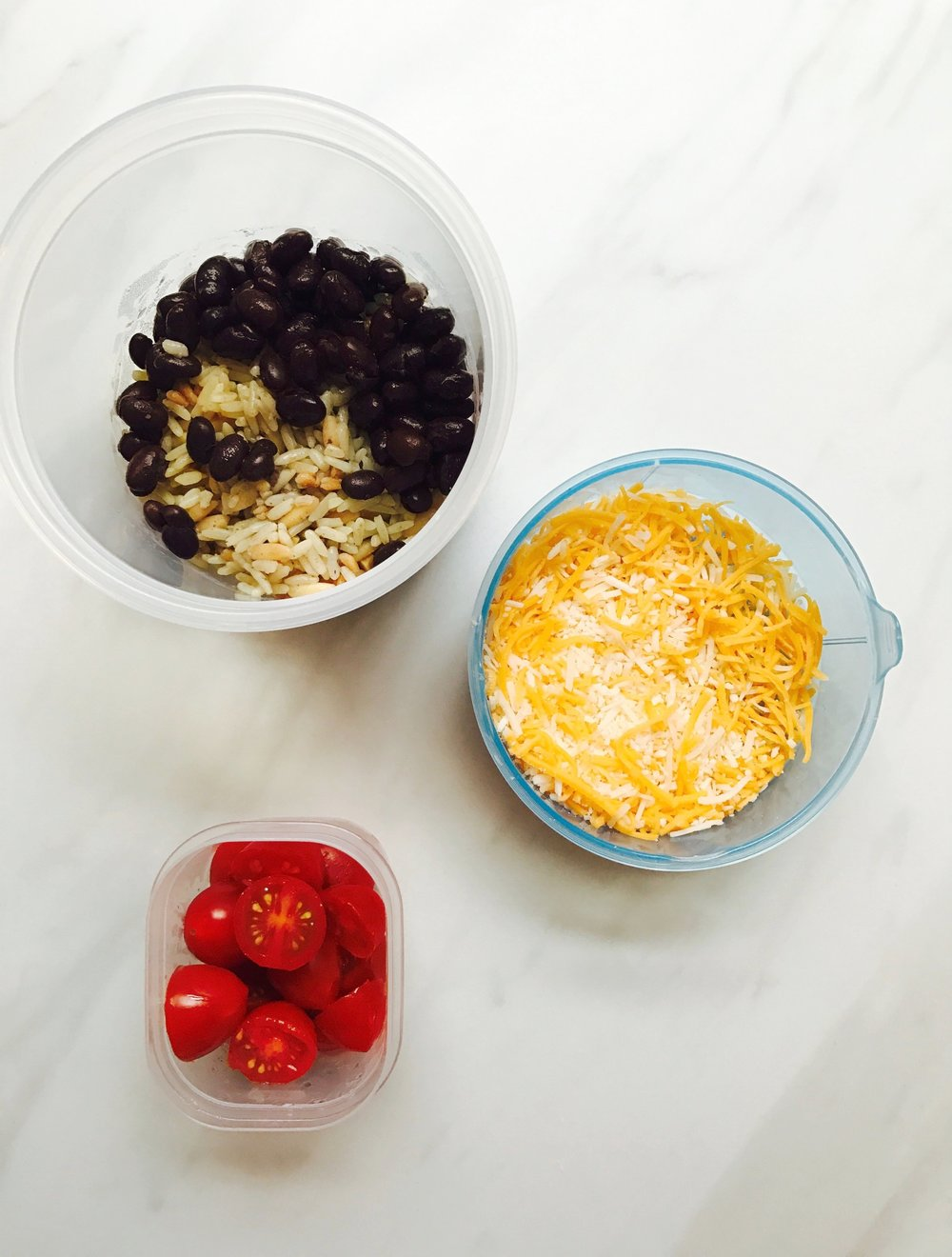 Black bean salad - black beans, rice, shredded cheese, and tomatoes. These are usually leftovers from dinner the night before so it's easy for me to pack.