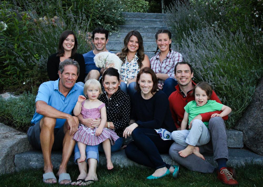 We are The Family Olson Top Row (left to right) - Blythe, Dan (Marissa's husband), Marissa, Kiki. Bottom Row (left to right) - Bruce, Molly J, Ilsa (Molly M's daughter), Molly M, Robb (Molly M's husband), Espen (Molly M's son).