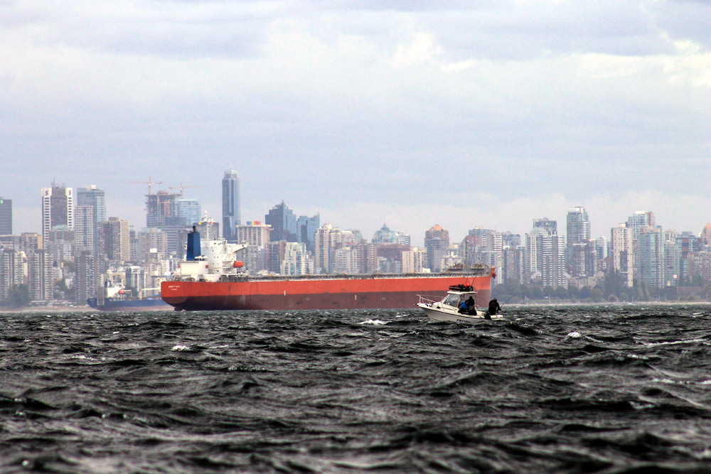 Fishing boat with freighter in Vancouver harbor. Photo by  Todd Martin .