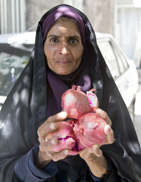 Woman with pomegranates. Photo by Paul Ross