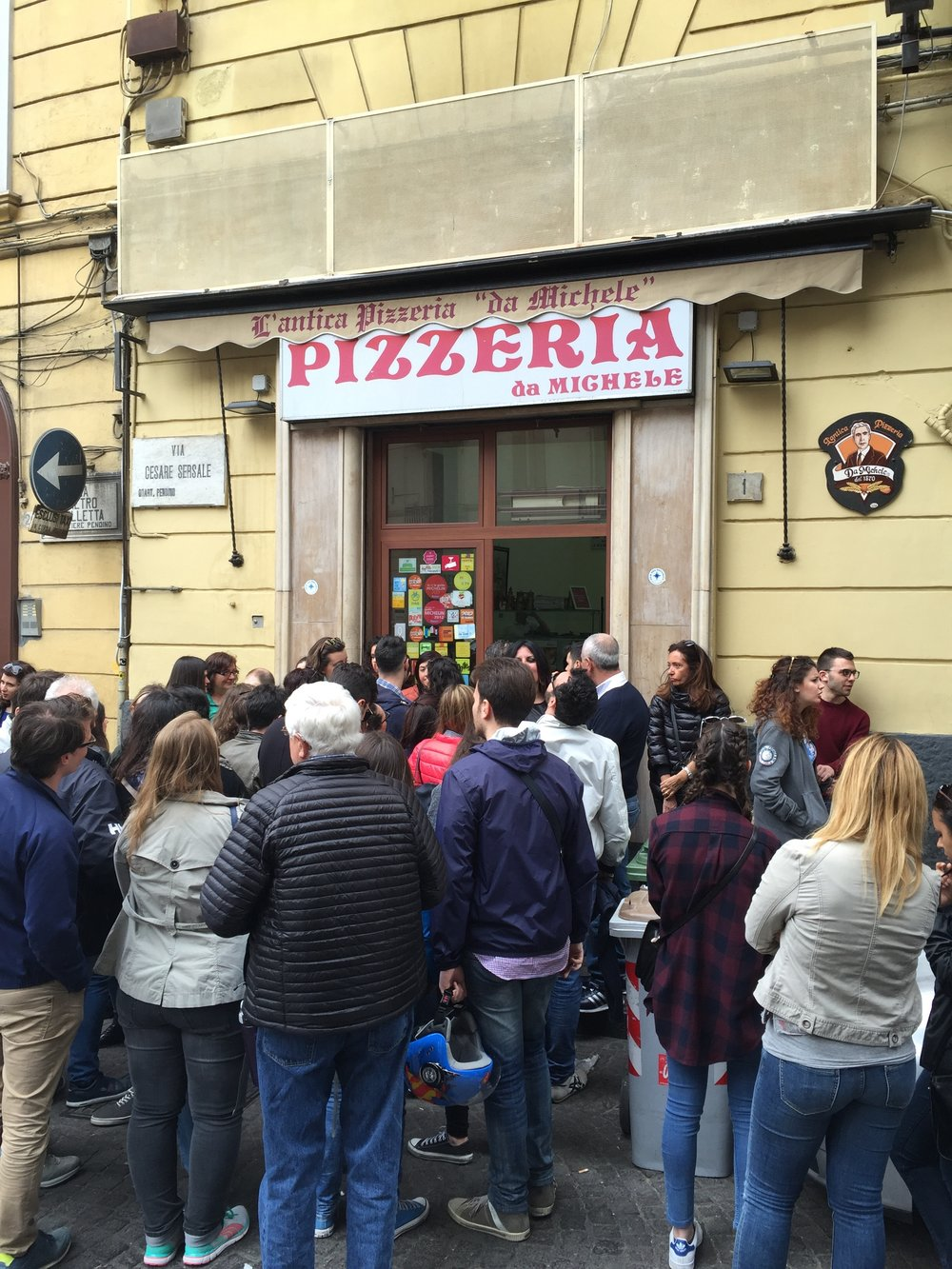 Da Michele, the holy grail of pizzerias, and the crowd waiting for their number to be called.