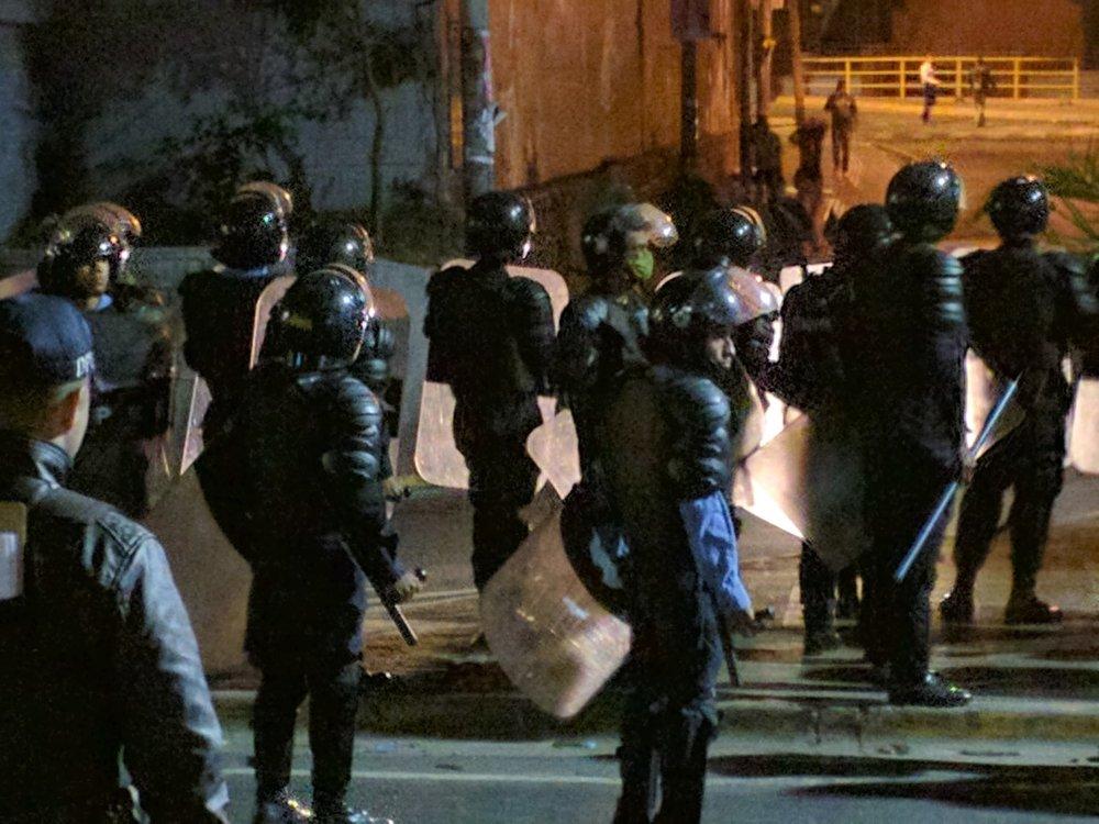 Riot police stand prepared in Honduras.