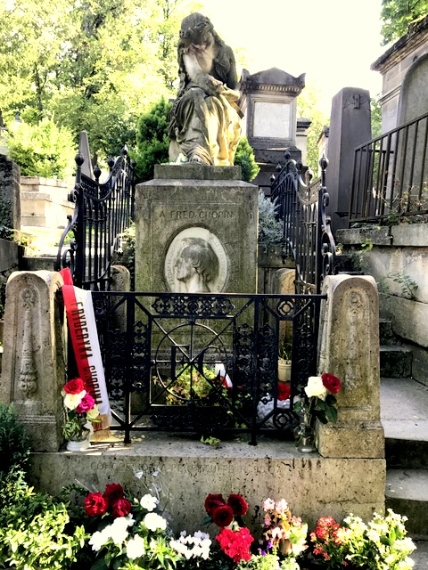 Chopin's grave, Père Lachaise Cemetery, Paris, France.Grave of Suzon Garrigues, killed at The Bataclan Theatre terrorist attack, Père Lachaise Cemetery, Paris, France.