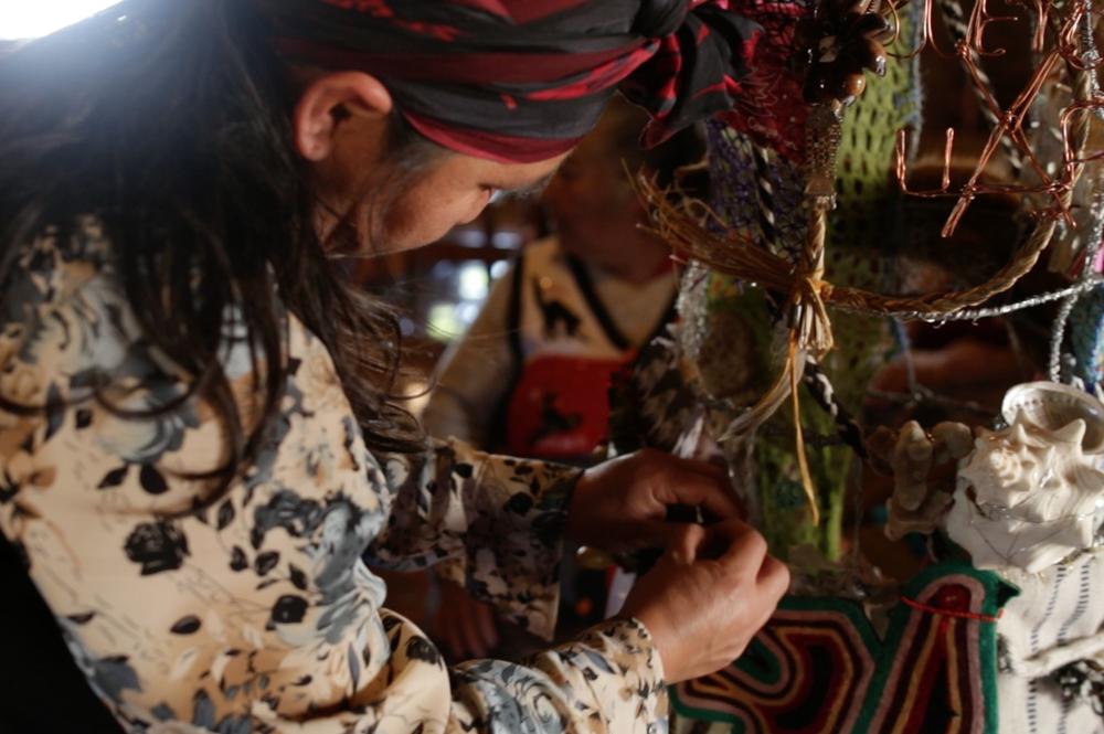 Francisca working on dress.JPG