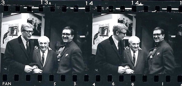 Michael Caine, cinematographer Otto Heller, and Len Deighton. Contact strip of rarely seen photographs by Jack Nisberg outside London's Leicester Square Theatre at the opening of The Ipcress File on 18 March 1965.© Jack Nisberg / Roger-Viollet. No reproduction without permission.  Jack Nisberg (1922-1980) was a freelance American photographer who worked mainly for Look, Newsweek, The Observer, The New York Times, The Sunday Times, Elle and Vogue. After moving to Paris in 1955, he became a sought-after photographer for cultural, political and social events, in addition to photojournalistic assignments. A friend of Len Deighton, he was also on hand to photograph the only meeting of Deighton and Ian Fleming at a luncheon hosted by Peter Evans in March 1963. Jack Nisberg's work is being rediscovered by cultural historians and collectors, and his archive is now managed by the French agency Roger-Viollet.