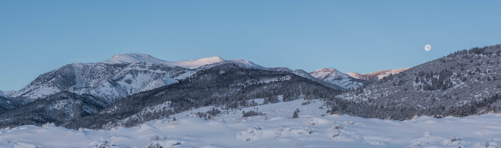 Moon setting over snowy Mt. Rose