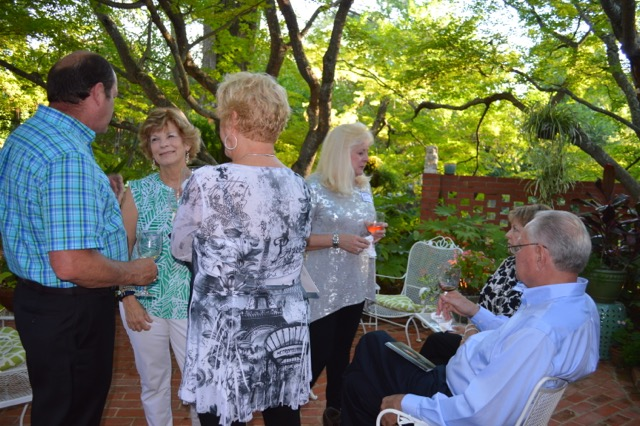 Guests gather in the lovely gardens of the Heines home.