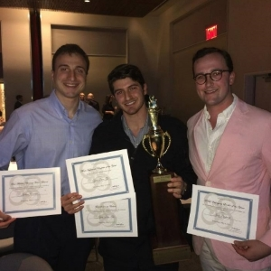 "Brothers of ZBT collecting their ""Chapter of the Year"" trophy at the FSL awards banquet."