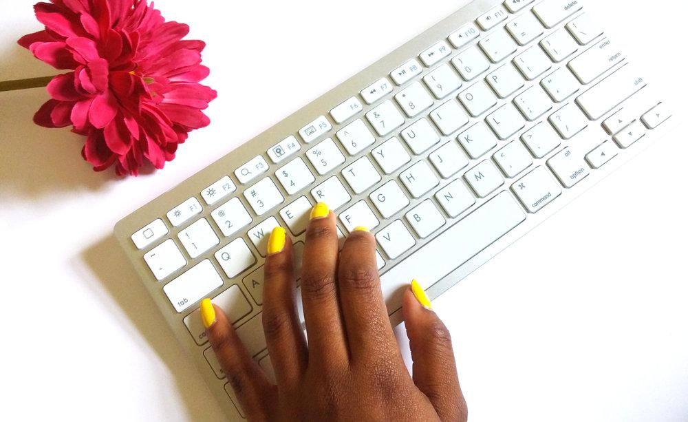 Keyboard and yellow nails