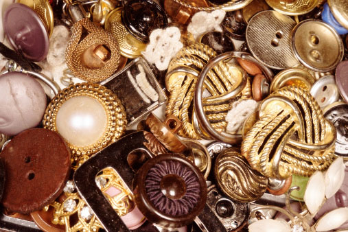 Shown: vintage gold buttons items that can be recycled profitably by GoldRefiners.com, part of Specialty Metals Smelters & Refiners.