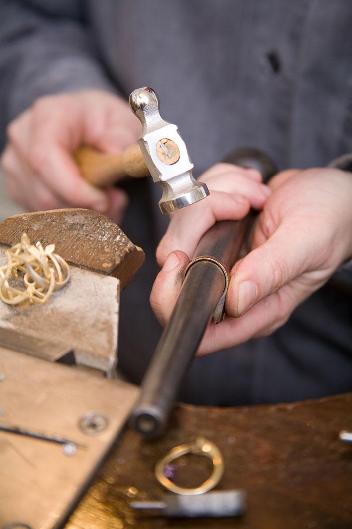 Hand forging karat gold rings. Credit: Tamßs Ambrits/Hemera.